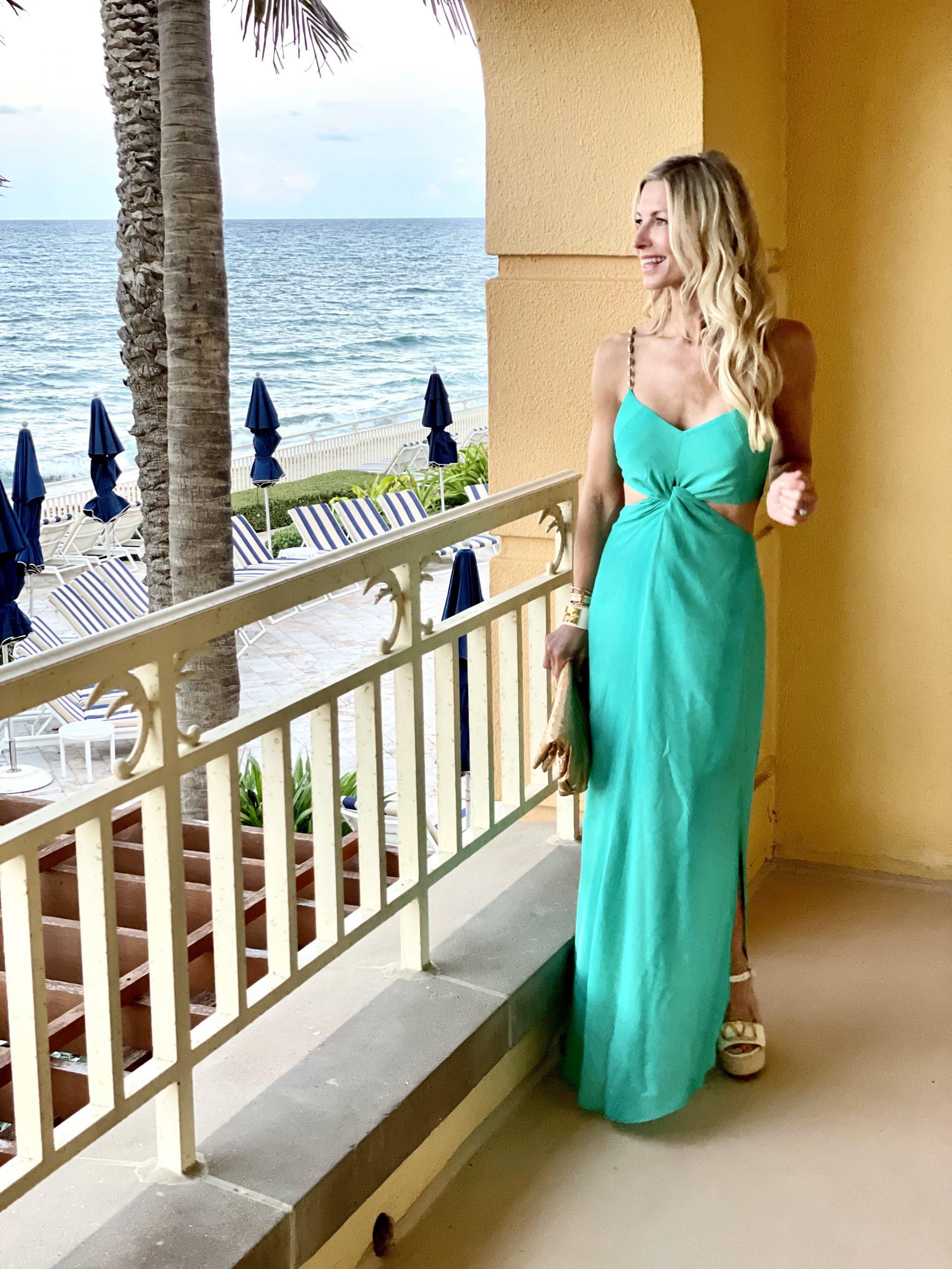 girl in floor length green dress
